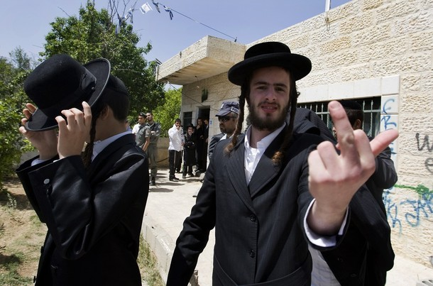 An Ultra-Orthodox Jewish man gestures as