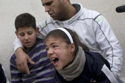 Palestinian family cry after their home was demolished by Israeli forces in the East Jerusalem2