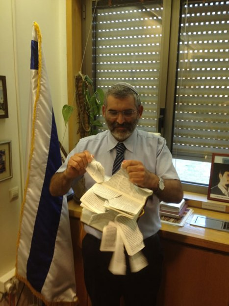Israeli Knesset Member Michael Ben-Ari shreds a copy of the New Testament benari