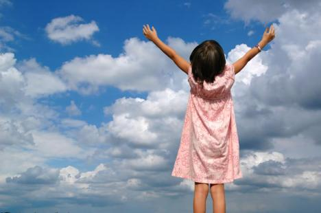girl-with-arms-open-wide-to-the-sky