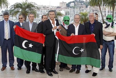 Director Levy and cast members pose during a photocall for the film Le Serment de Tobrouk at the 65th Cannes Film Festival