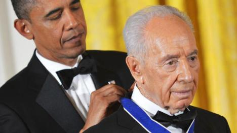 Barack Obama has awarded the Presidential Medal of Freedom to Criminal Israeli President Shimon Peres